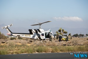 Air Rescue helicopter landed along Highway 395 to transport a seriously injured patient to a trauma hospital. (photo by Hugo C. Valdez, Victor Valley News)