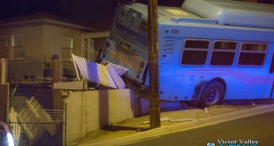 A bus rolled down a hill and was stopped by a concrete wall. (Hugo C. Valdez, Victor Valley News)