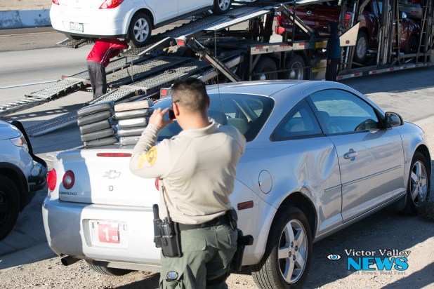 A Sheriff's officer photographed the packages of suspected narcotics on Monday afternoon. (Gabriel D. Espinoza)