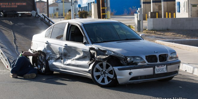 A silver BMW ran a red light and caused an early morning traffic accident. (Hugo C Valdez)