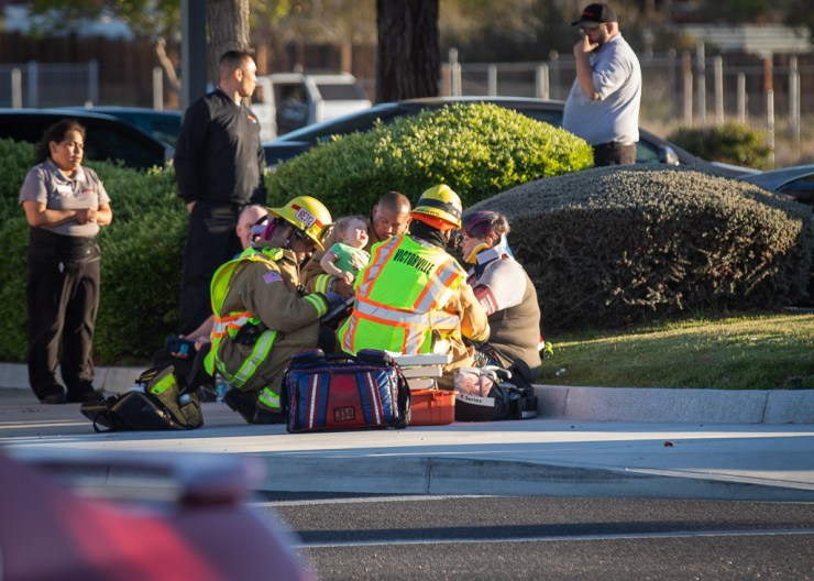 Firefighters treated a young child who was inside the gold Hyundai with her family during the time of the crash. (Gabriel D. Espinoza, Victor Valley News)