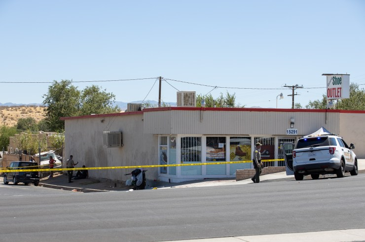 Deputies interviewed several people who were sitting on the side of the building near a shopping cart. (Gabriel D. Espinoza, Victor Valley News)