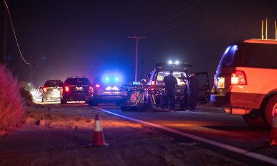 The coroner preparing to remove the body from the roadway. (Gabriel D. Espinoza, Victor Valley News Group)