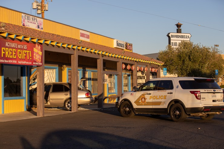 Victorville Police Department waits for the owners of the business to arrive. (Hugo C. Valdez, Victor Valley News Group)