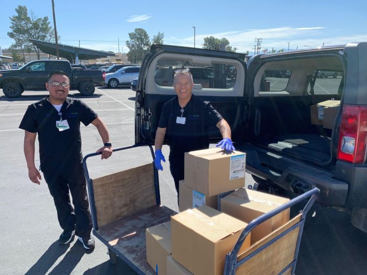 (Hospital staff members at St. Mary Medical Center accept a donation of masks from Victor Valley College.)