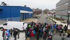 An impressive crowd of volunteers gathers to spend the day cleaning in the cold.