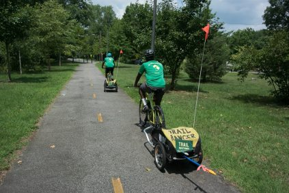 Back on the Marvin Gaye Trail. The flagging tape is useful to warn other road and trail users of our long broom handles