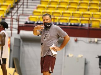 Chris Jans coaching.