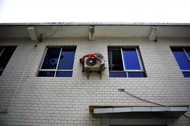 Epic Fail Picture of How To Remove Air Conditioner - Safety First