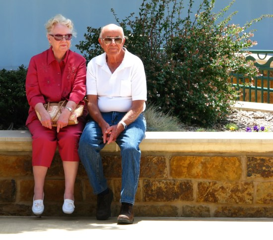 Photo of elderly couple sitting outside
