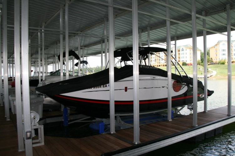 wahoo aluminum docks commercial community dock and marinas with jet ski docking - gable roofs with wood gangway - ipe covered dock decking