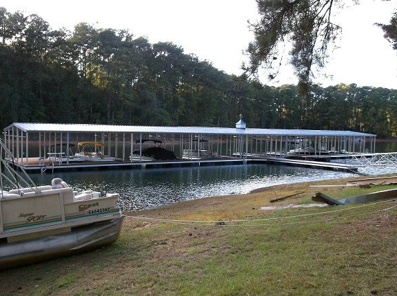 wahoo aluminum docks commercial community dock with gable roof and gangway with cuppola and dock decking