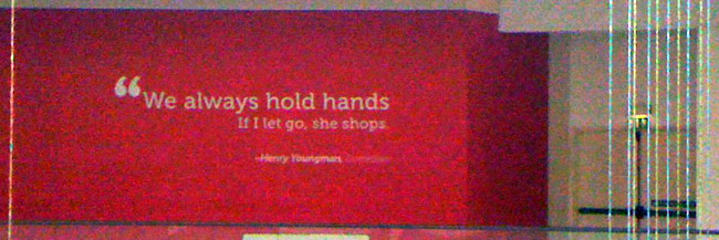 We always hold hands. If I let go, she shops. -Henny Youngman Dubai Mall Wall Quote