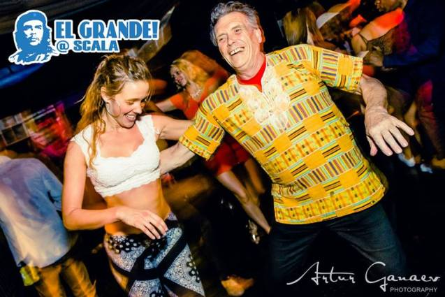 Click on the photo to see my facebook profile pictures which lately depict me salsa dancing wearing a Kente shirt! :)