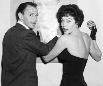 "1955 --- 1955-Reconciled? -- Filmdom's Stevenson supporters got a pleasant surprise last night (Mon.) when Frank Sinatra and Ava Gardner, reported separated, appeared together for the first time in more than a week, at a mammoth Stevenson rally at the Palladium. They have apparently patched up their domestic difficulities and Sinatra sang, ""When You're Smiling, the Whole World Smiles With You."" Miss Gardner introduced ""my husband"" to the rally audience as ""a wonderful, wonderful man."" Photograph dated 1955. BPA 2# 1423 --- Image by © Bettmann/CORBIS"