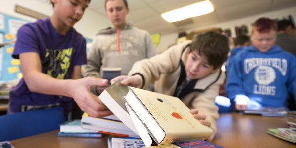CHERRYFIELD, MAINE -- 01/21/2016 -- Cherryfield Elementary School sixth-graders sort donated books in english teacher Emily VanOrmer's class for the Cherryfield Free Public Library. Pictured are from left: Jackson Murphy, Isaac Bailey, Andrew Caplin and Laine Borer.  Gabor Degre | BDN