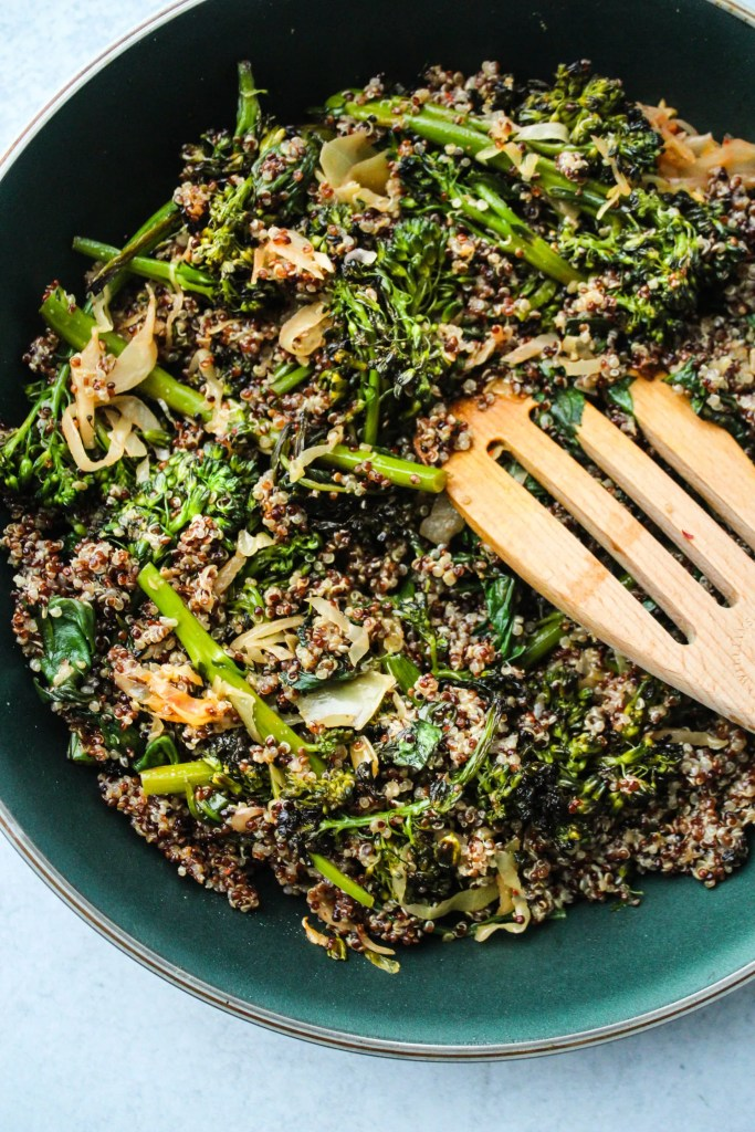 pan with kimchi, quinoa, broccolini, spinach stir fry