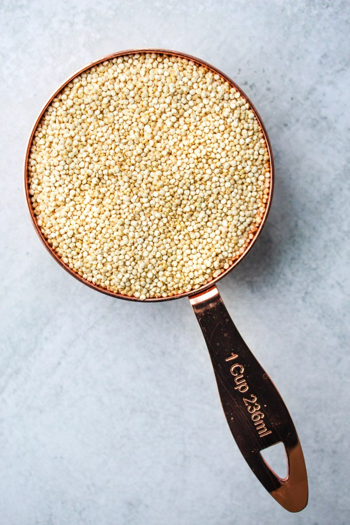 uncooked quinoa in a measuring cup