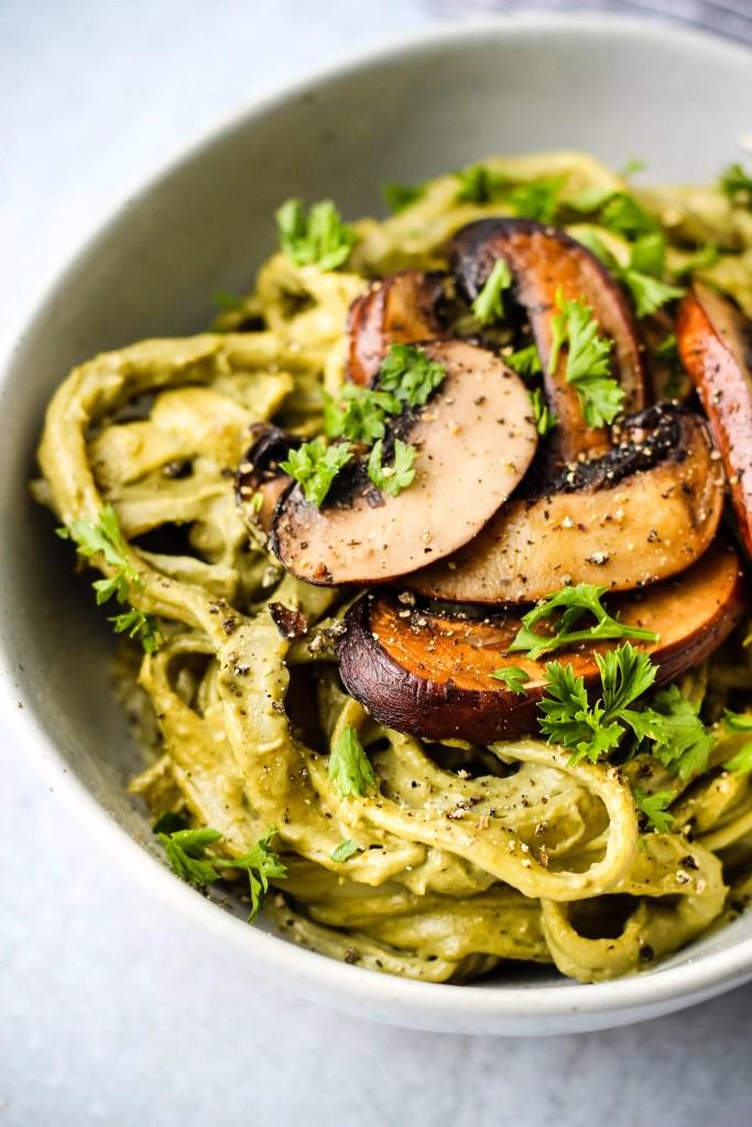 vegan mushroom cashew cream pasta topped with mushrooms in a bowl