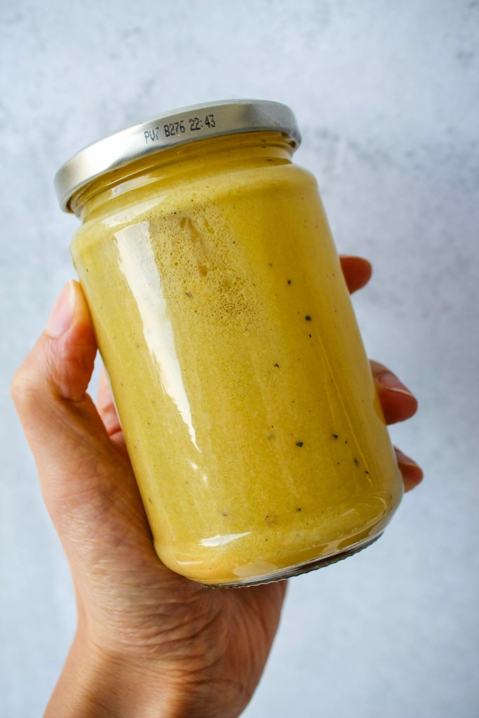 homemade dijon vinaigrette in small glass jar