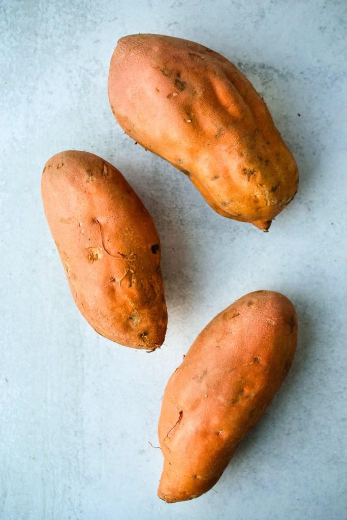 three sweet potatoes