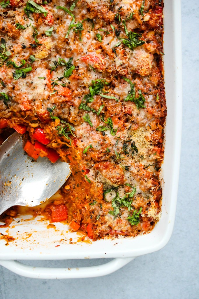 baked spaghetti squash casserole with tempeh bolognese in white baking dish