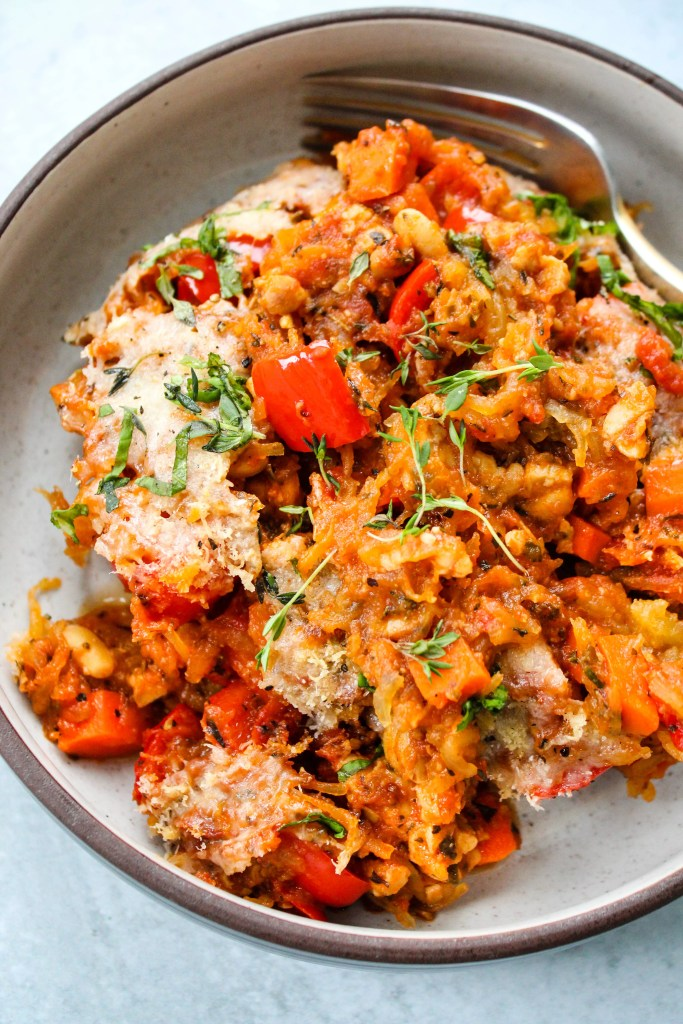baked spaghetti squash casserole with tempeh bolognese in bowl