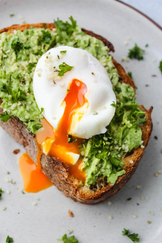 avocado toast with one poached egg