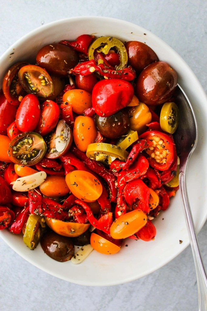 white bowl with chopped tomatoes and peppers