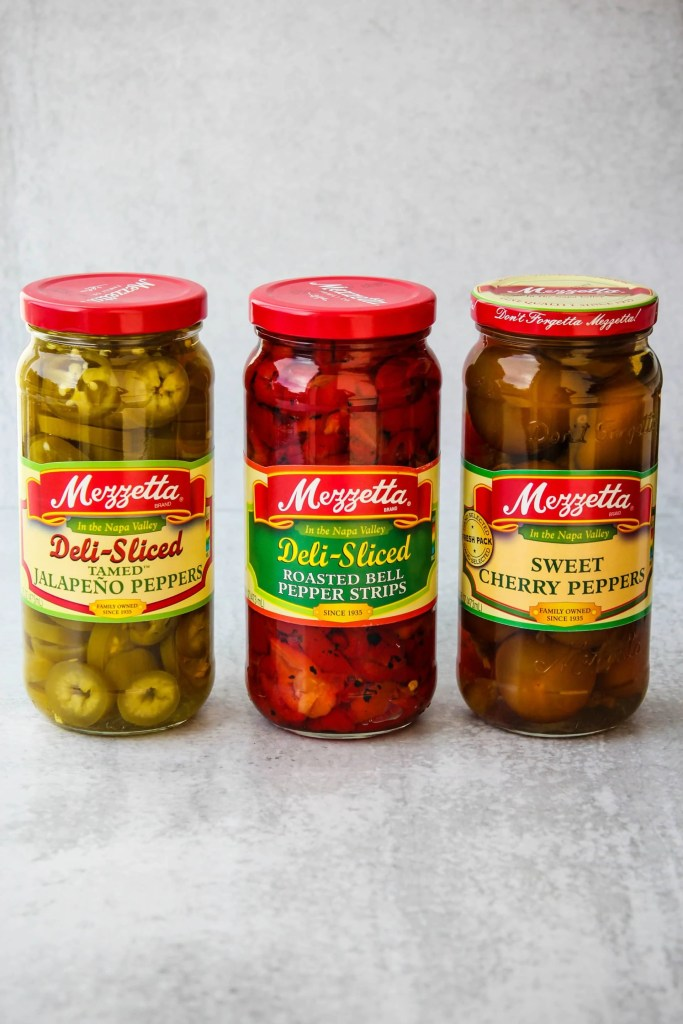 three jars of peppers