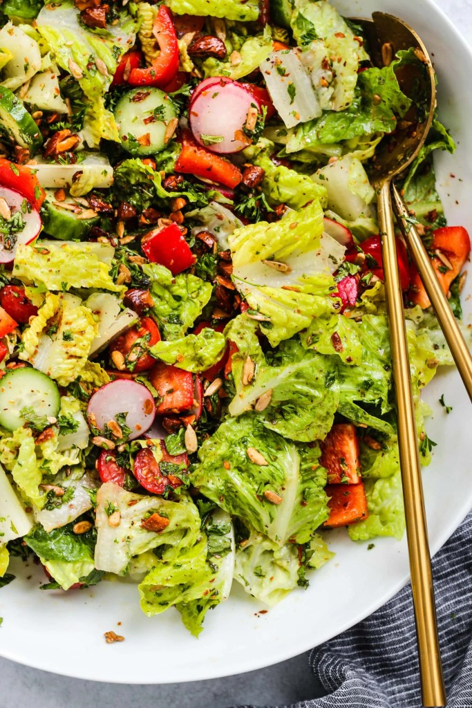 white bowl with crunchy chopped romaine salad