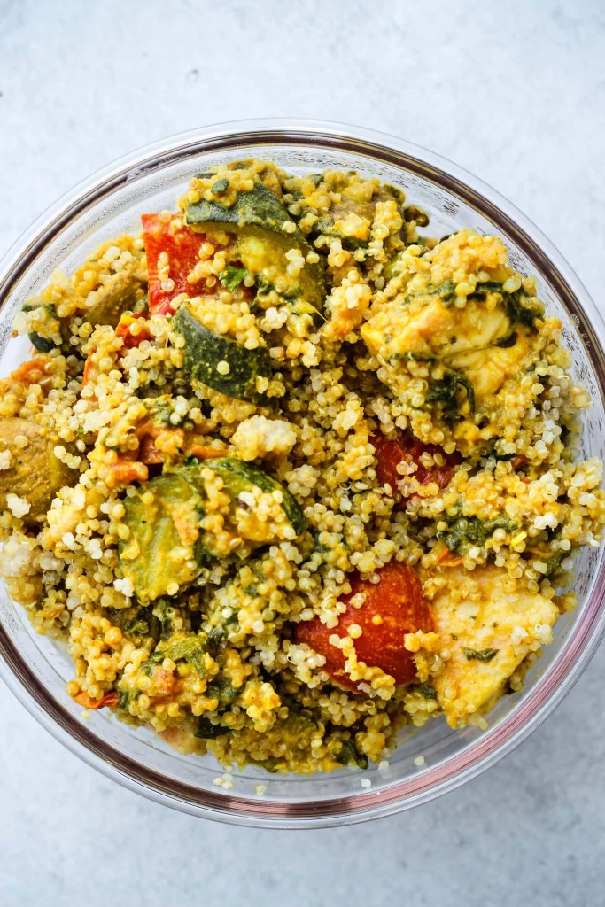 Leftover coconut curry tofu, vegetables, and quinoa in glass container
