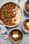 rosemary apricot crisp in white baking dish and three small serving bowls