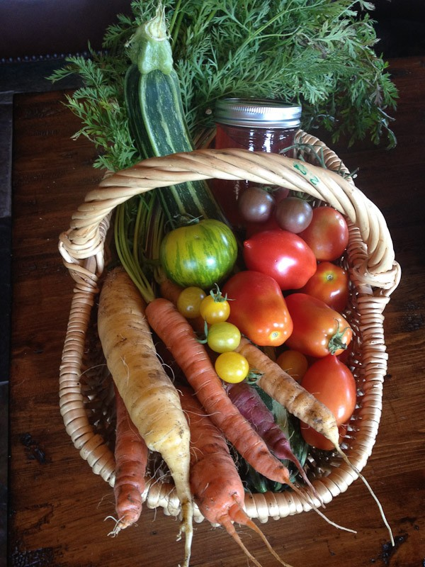 baskets of homemade preserves and vegetables to thank neighbors