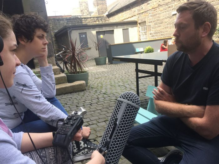 Morvern and Andy pause for thought during Talking Feet podcast recording in Customs Lane