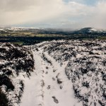 Snow covered path above lower wharfedale