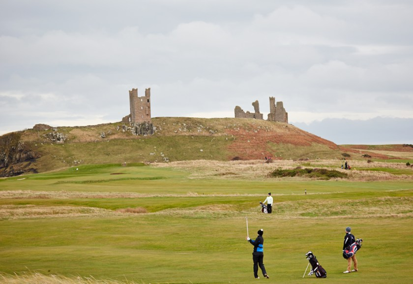 Playing golf outside Dunstanburgh Castle