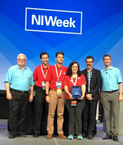 The Delacor leadership team receives the LabVIEW Tools Network Product of the Year award