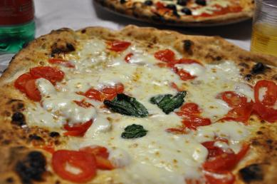 A traditional pizza margherita of Naples, complete with the thick crust