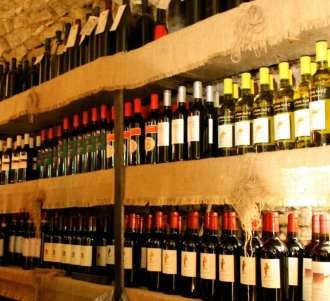 Shelves of wine at an Italian enoteca. Find out the secrets to enjoying Italian Wine!
