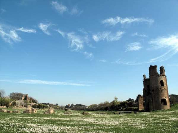 The view across the circus of Maxentius near his villa on the Via Appia Antica, showing the still-standing brick towers on the western end of the circus. Photo from the Institute for the Study of the Ancient World as part of the Ancient World Image Bank
