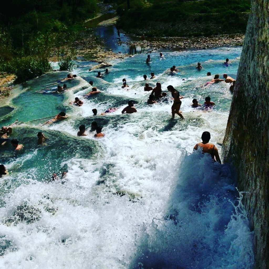 Bathers lounge in the geothermic pools of Tuscia's Terme di Saturnalia.