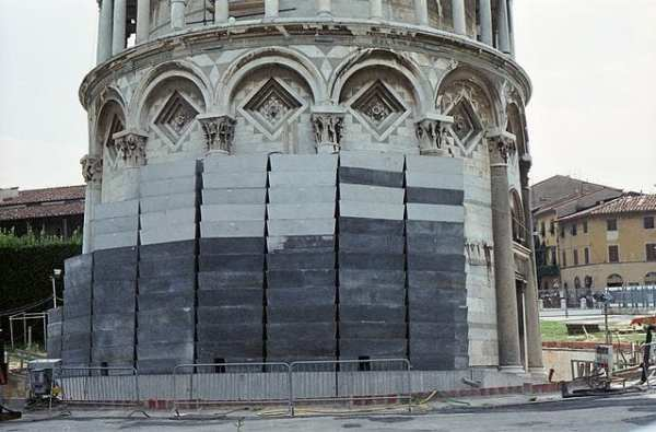 Lead counterweights are stacked on the tower during restoration in 1998. Photo by Rolf Gebhardt