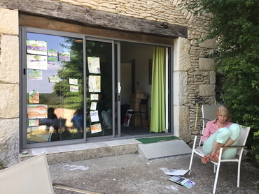Artist in front of her watercolors during our painting retreat in France