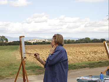Artist painting in Tuscany during Walk the Arts art workshops in Italy