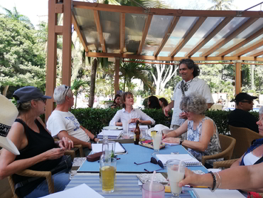 Group of artists and foodies around a table during Walk the Arts art and culinary workshop in Colombia South Amercia