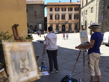 Artists painting during our plein air painting workshop in Tuscany Italy