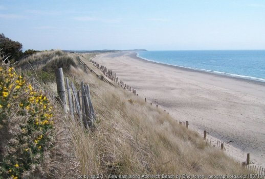 View east along Abererch Beach This sandy beach stretches eastwards as far as the Pen-ychain headland seen in the distance.