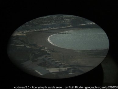 Aberystwyth sands seen through the camera obscura The camera obscura seen on top of Constitution Hill in the photograph SN5882 : Looking up towards the camera obscura gives a fascinating live and moving image of scenes far below in Aberystwyth, projected using mirrors onto a round table in a darkened room. The technology involved is very dated, but the experience is unique and not to be missed.