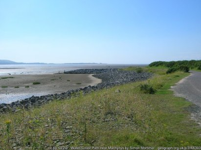 Wales Coast Path near Machynys Looking west, with Whiteford Point on the end of the Gower peninsula visible in the distance across the Loughor